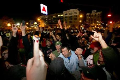 Fans celebrated under the Citgo sign in Kenmore Square.