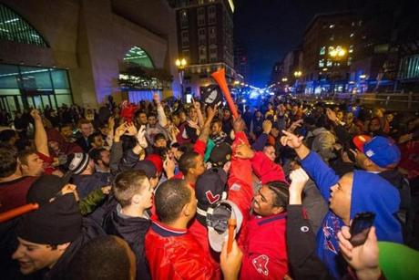 Fans celebrate on Boylston Street, atop the finish line of the Boston Marathon. Fans rejoiced at the spot where two bombs exploded in April, killing three people and injuring more than 260.