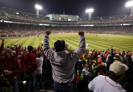 Red Sox fans in Fenway Park celebrated after the Red Sox took the lead in the fourth inning.
