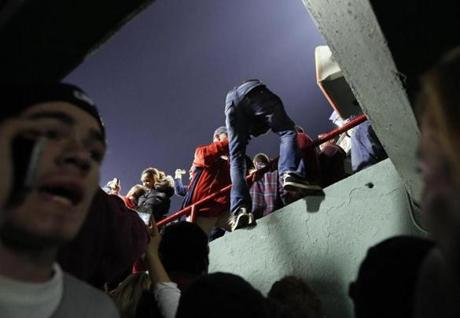 A Boston Red Sox fan climbed into the stadium after fans outside stormed Gate B and ran into the ballpark.