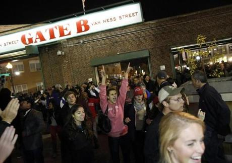Sox fans outside Fenway Park stormed Gate B and ran into the ballpark.