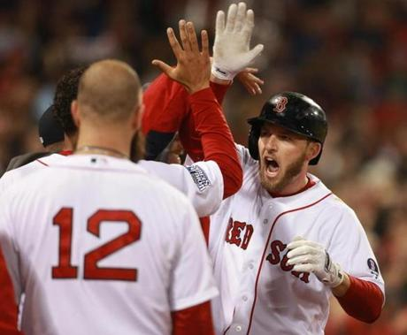 Boston's Stephen Drew was congratulated by teammates after hitting a home run.
