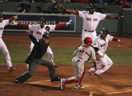 Boston's Jonny Gomes slid home in the third inning. He was called safe at the plate.