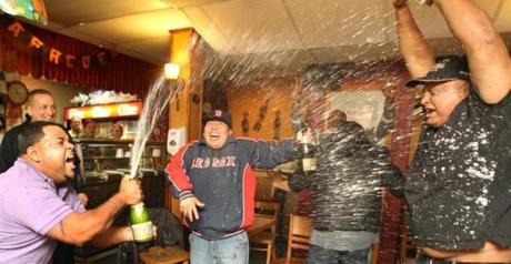Fans at Latino Restaurant in Jamaica Plain celebrated the win.