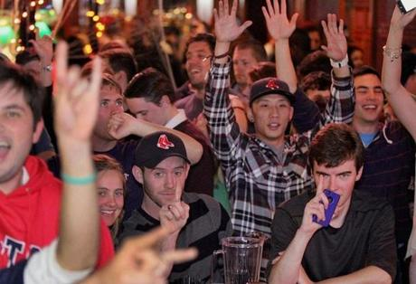 Fans at White Horse Tavern in Allston celebrated as the Red Sox clinched the World Series.