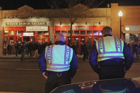 Just under two miles away from Fenway In Allston, Boston Police kept watch as fans left bars.