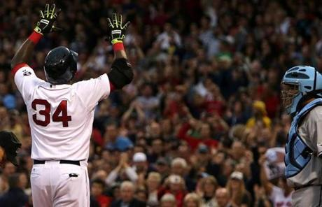 In Game 2, David Ortiz hit two home runs to lead the Red Sox to a 7-4 win and a 2-0 series lead.