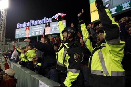 These BU police officers celebrated when the Red Sox rallied to add three more runs in the fourth inning.