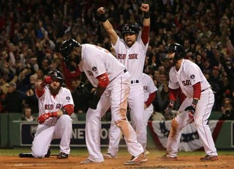 David Ortiz slid home with the third run on a three-run double clubbed by Mike Napoli in the first inning of Game 1.