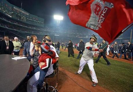 Jonny Gomes and many players also came back out onto the field to celebrate with fans inside Fenway Park.