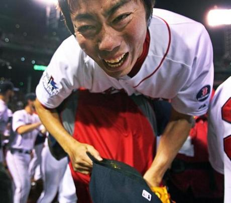David Ortiz lifted Koji Uehara in celebration in the moments after the game.