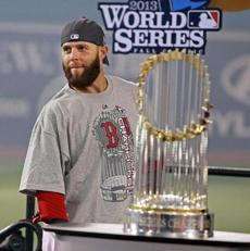 Dustin Pedroia was able to stand with the World Series trophy for the second time in his career.
