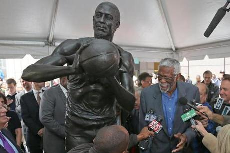 Boston Celtics Hall-of-Famer Bill Russell was surrounded by former teammates and others Friday as his statue was unveiled on City Hall Plaza.
