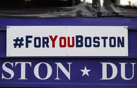A sign hung on one of the Duck Boats participating in the parade.