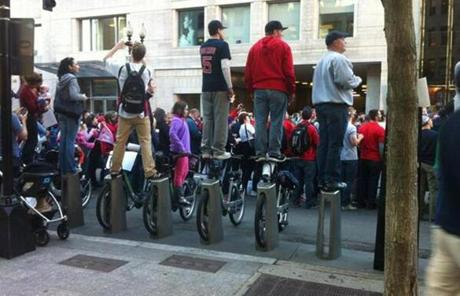 Fans stood atop a Hubway bike station to get a better look at the parade.