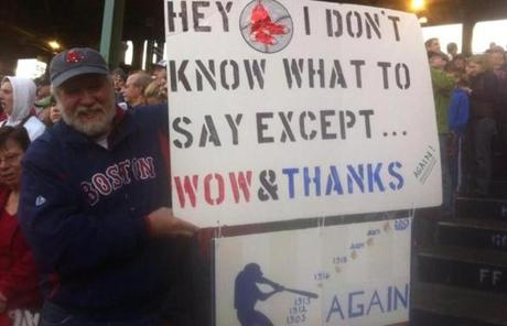 A fan held up a sign thatnked the Red Sox.
