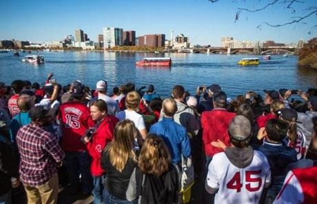 The duck boats carrying Red Sox players were seen from the Esplanade.