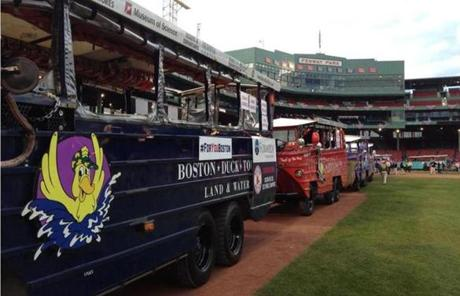 Duck Boats lined up at Fenway in preparation for the rally
