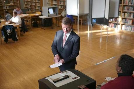 Rep. Marty Walsh voted with his partner, Lorrie Higgins, and her daughter Lauren Campbell at the Cristo Rey School.