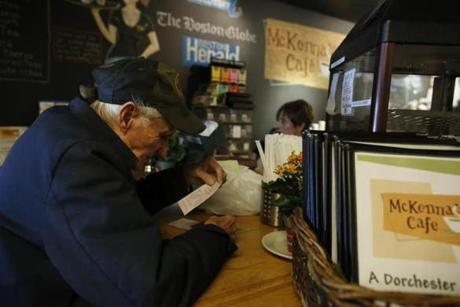 George Kelly, 79, playing lotto at McKenna's Cafe, has known Walsh since he was a boy, and knew his father before that.