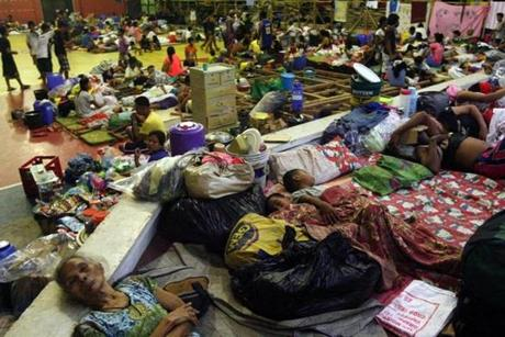 Residents slept on the floor as they sought refuge inside a gymnasium in Sorsogon City. Thousands were evacuated from coastal communities.