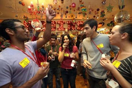 Omar Aniff (left) of Boston gives a thumbs up during a licorice tasting at Robin's Candy on Newbury Street.
