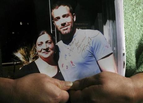 Maria Delvecchio of Trattoria Il Panino holds an autographed photo of  herself with Ben Affleck.