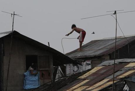 Residents reinforced their homes in a village south of Manila.