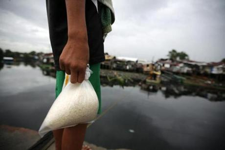 A resident held onto a kilo of rice.