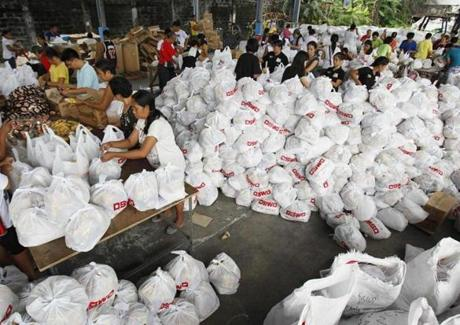 Volunteers packed relief goods inside a Department of Social Welfare and Development warehouse on Friday.