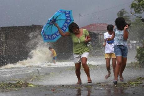 Residents struggled against strong winds from Typhoon Haiyan on Friday in Bayog town.