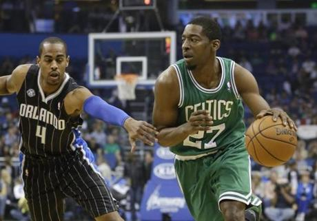 Boston Celtics' Jordan Crawford (27) drives around Orlando Magic's Arron Afflalo (4) during the first half of an NBA basketball game in Orlando, Fla., Friday, Nov. 8, 2013. (AP Photo/John Raoux)