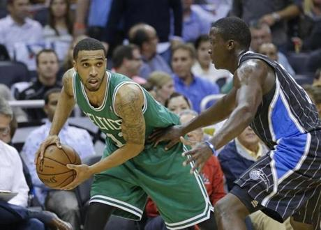 Boston Celtics' Courtney Lee, left, looks to pass the ball around Orlando Magic's Victor Oladipo during the first half of an NBA basketball game in Orlando, Fla., Friday, Nov. 8, 2013.(AP Photo/John Raoux)