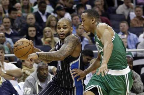Orlando Magic's Jameer Nelson, left, drives around Boston Celtics' Avery Bradley during the second half of an NBA basketball game in Orlando, Fla., Friday, Nov. 8, 2013. (AP Photo/John Raoux)
