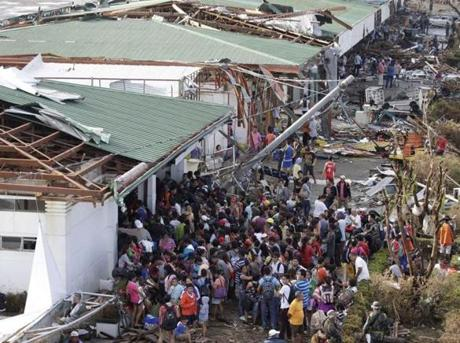 Residents lined up to receive treatment and relief supplies at Tacloban airport Monday.