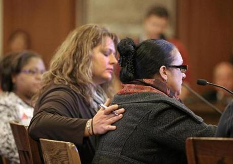 Erin Manning comforted domestic worker Sonia Soares during her testimony in support of the Domestic Workers' Bill of Rights at the Massachusetts State House.