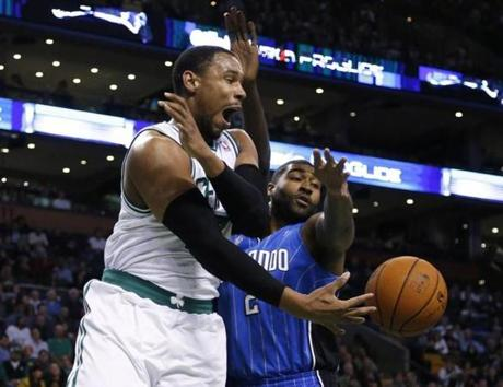 Celtics forward Jared Sullinger drove baseline and dished to a cutting Vitor Faverani while being guarded by Magic forward Kyle O'Quinn at the TD Garden.