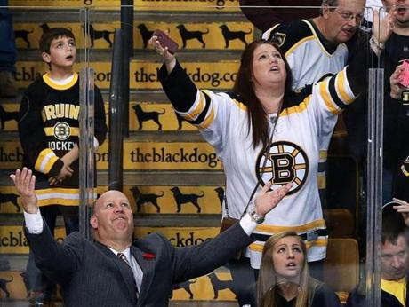 Bruins head coach Claude Julien and a fan seated behind him had the same reaction as they watched the replay of a third-period Boston goal that was disallowed for goaltender obstruction during Monday's game against the Lightning at TD Garden.