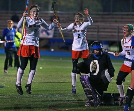 Emily Loprete (9) celebrated with teammates Alexandra Doggett (2) and Rachel Campbell (25) after she scored to cap off Watertown's 4-0 victory over Dover-Sherborn in the EMASS Division 2 field hockey championship at Braintree High School.