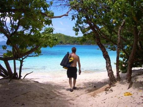 A snorkeler toted his gear to Hawksnest Bay, one of the pristine beaches that ring St. John.