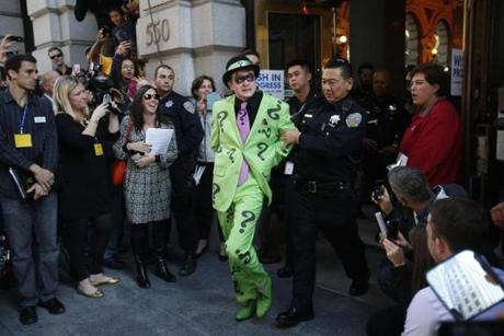 The heroes then took off to catch the Riddler as he robbed a downtown bank.