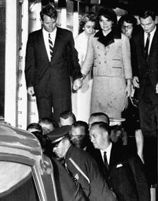 Friday, Nov. 22, 1963: Jacqueline Kennedy, with bloodstains on her clothes, held hands with her brother-in-law, Attorney General Robert Kennedy, as the coffin carrying the body of President John F. Kennedy was placed in an ambulance after arriving at Andrews Air Force Base.