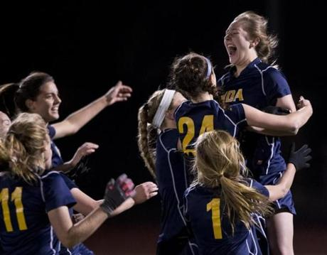 Notre Dame Academy (Hingham) players lifted Gabriela Kenyon after she made the game-winning penalty kick in a double overtime period against Wilmington High in the MIAA 2013 State Girls Soccer Division 2 Final at Manning Field.