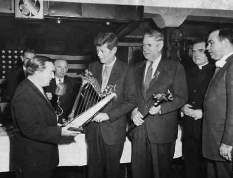 March 17, 1958: Senator John Powers was toastmaster at a corned beef and cabbage dinner for 260 legislators at Dorgan's Old Harbor House. Here he presented a golden harp to Senator John Kennedy.
