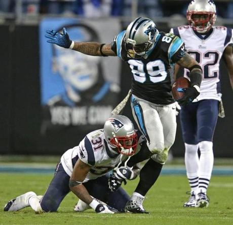 After getting beat for a pass reception, Patriots cornerback Aqib Talib held on to Panthers wide receiver Steve Smith, sparking an on-field scuffle in the first quarter.
