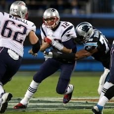 Patriots quarterback Tom Brady is sacked by Panthers defensive end Greg Hardy in the first quarter.