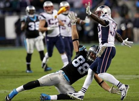 Free safety Devin McCourty is called for defensive holding penalty on Panthers tight end Greg Olsen on the game-winning drive in the fourth quarter.