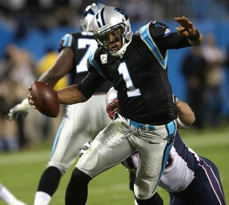 Defensive end Rob Ninkovich  looked to have Panthers QB Cam Newton in his grasp, but Newton broke the tackle and scrambled for a long gain and a first down.