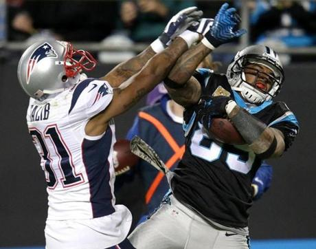 Panthers wide receiver Steve Smith  made a reception along the sidelines despite the defensive coverage of cornerback Aqib Talib.