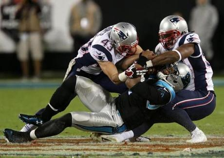 Defensive back Nate Ebner and outside linebacker Dont'a Hightower finally brought down Panthers quarterback Cam Newton after he scrambled for a first down  in the third quarter.